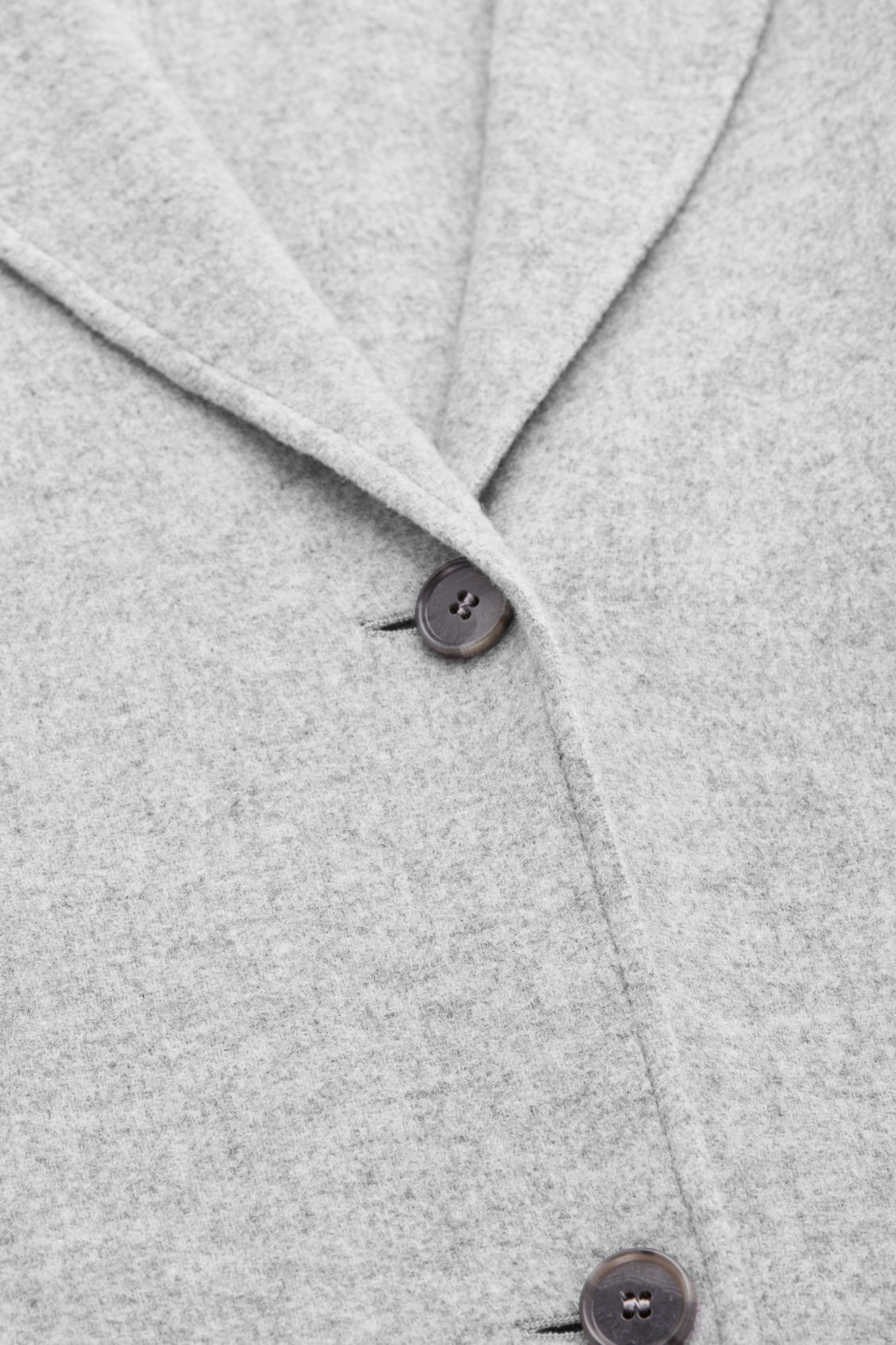 Side image of Cos wool coat with large pockets in grey