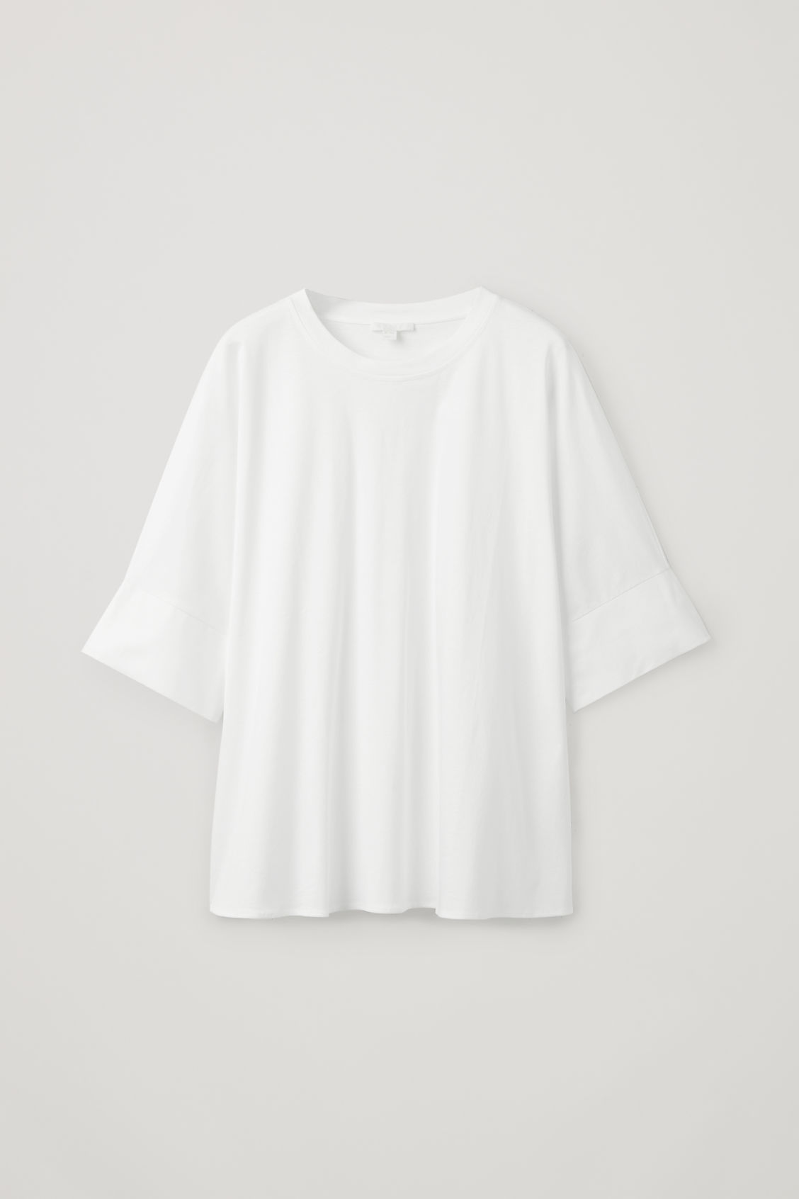 Front image of Cos kimono-sleeved a-line top in white