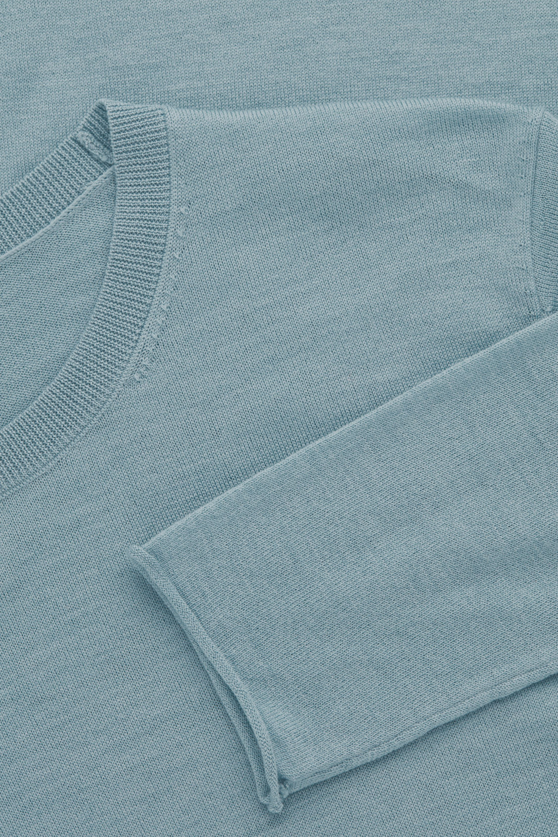 Side image of Cos merino round-neck jumper in turquoise