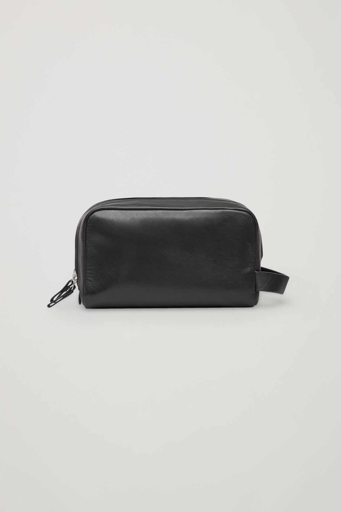 Front image of Cos leather wash bag in black