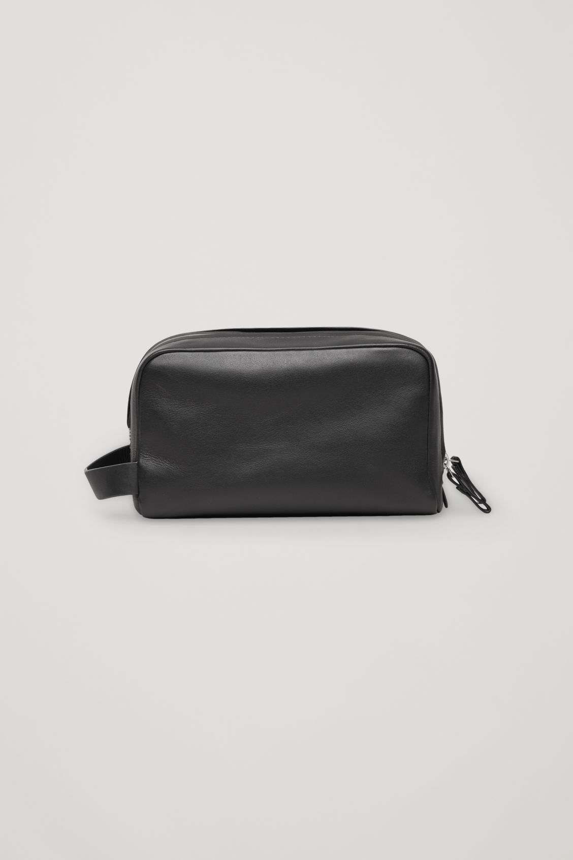 Side image of Cos leather wash bag in black