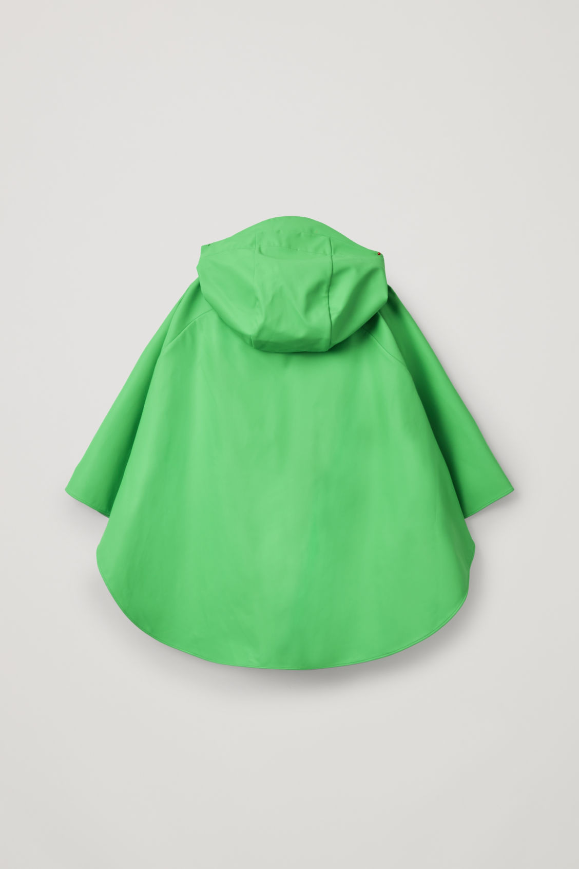 Side image of Cos raincoat with detachable hood in green