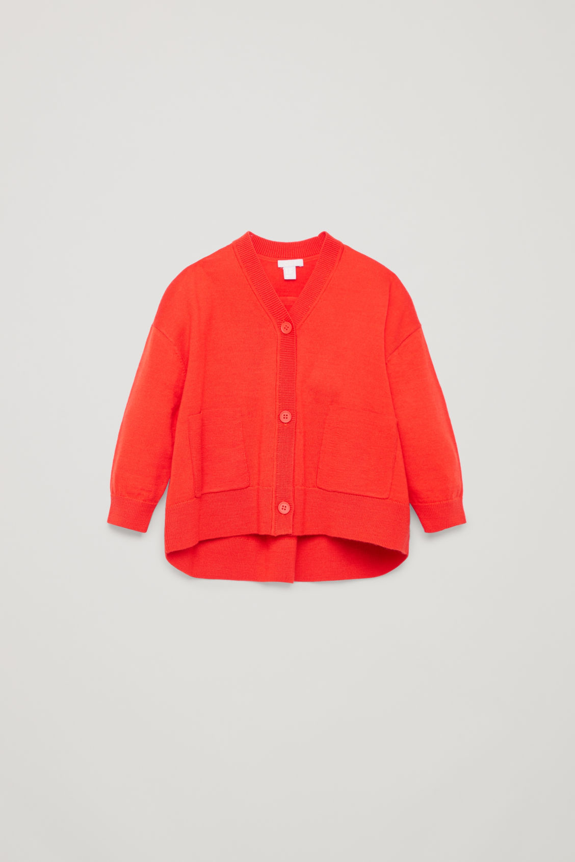 Front image of Cos curved merino-wool cardigan in orange