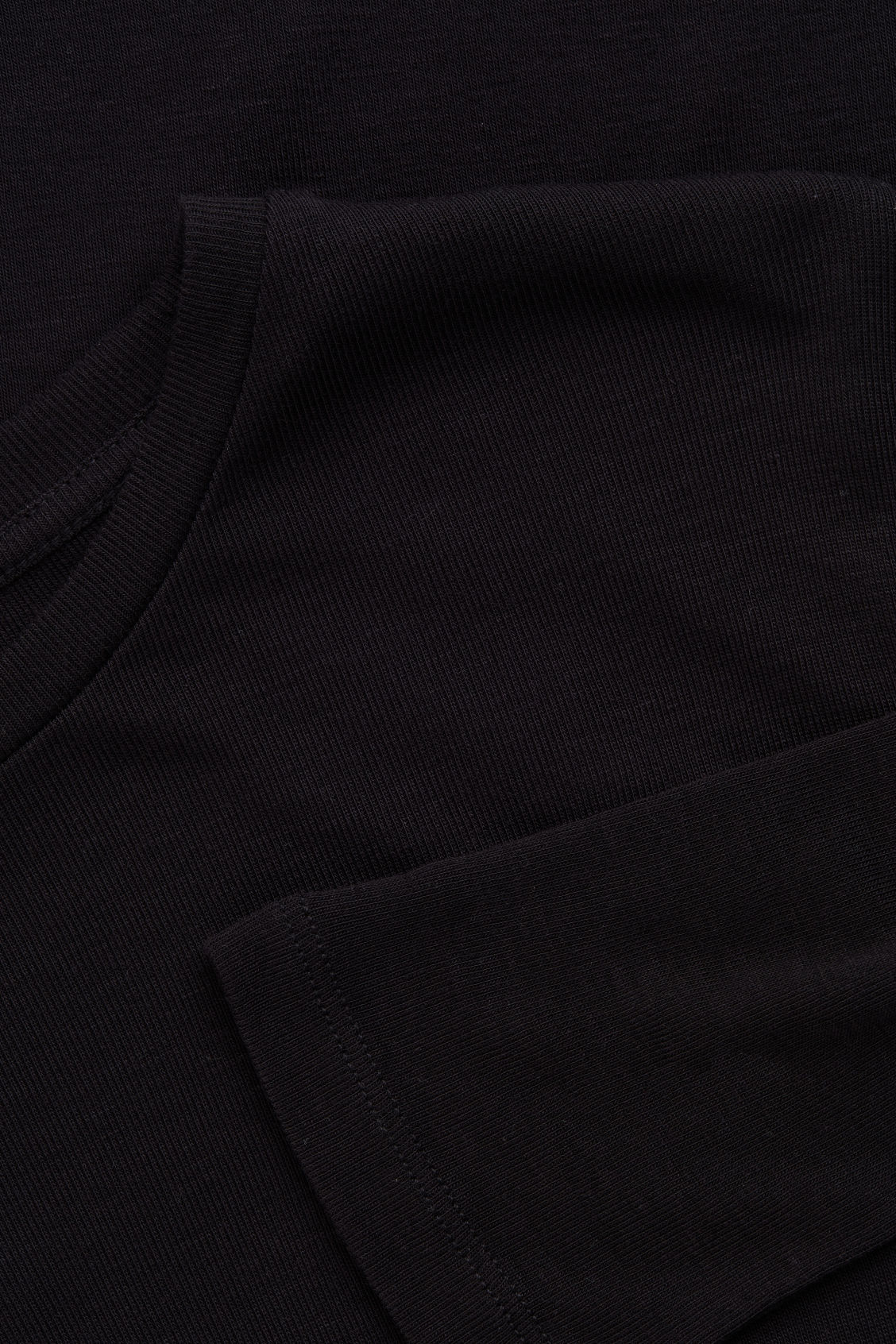 Side image of Cos round-neck jersey top in black