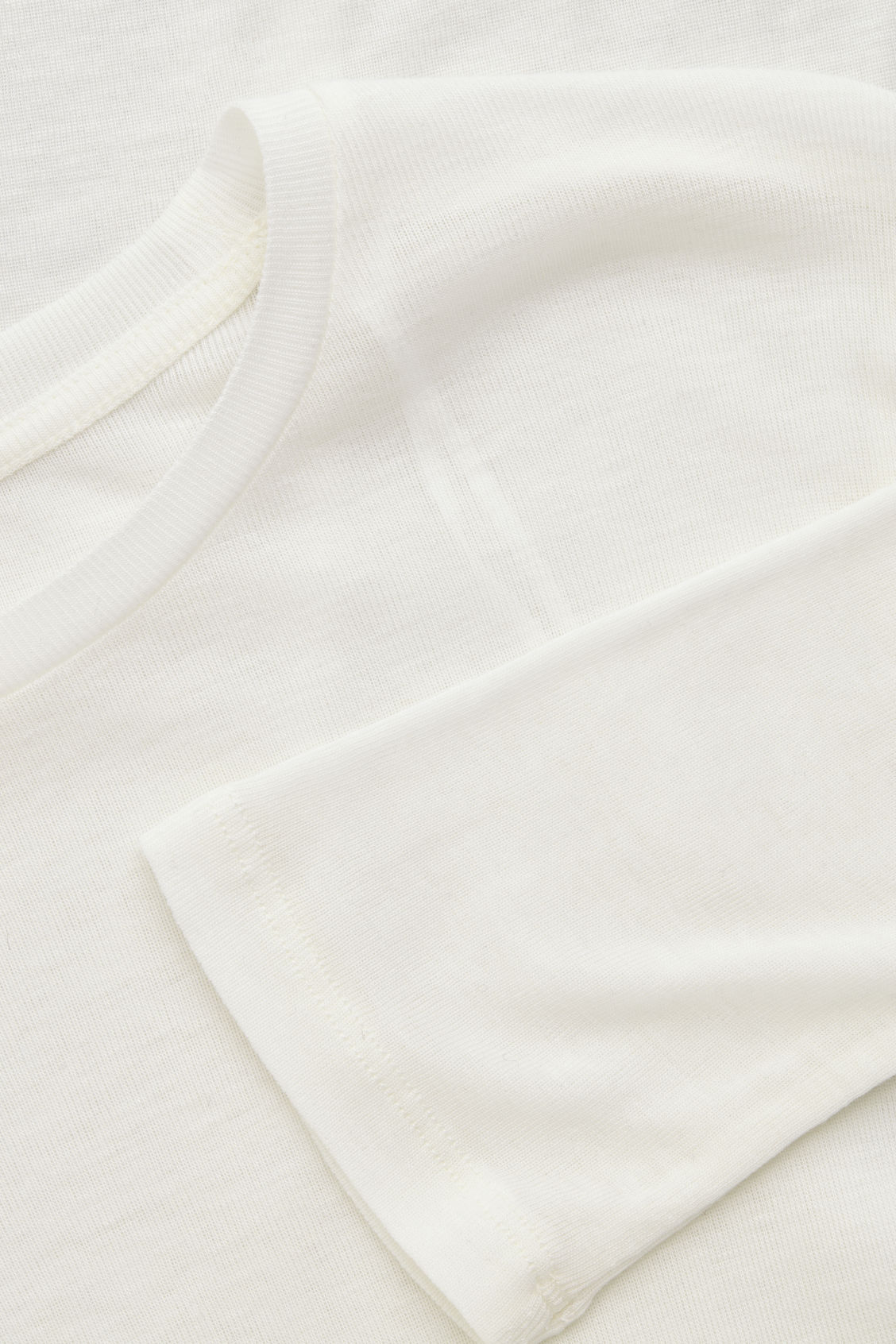 Side image of Cos round-neck jersey top in white