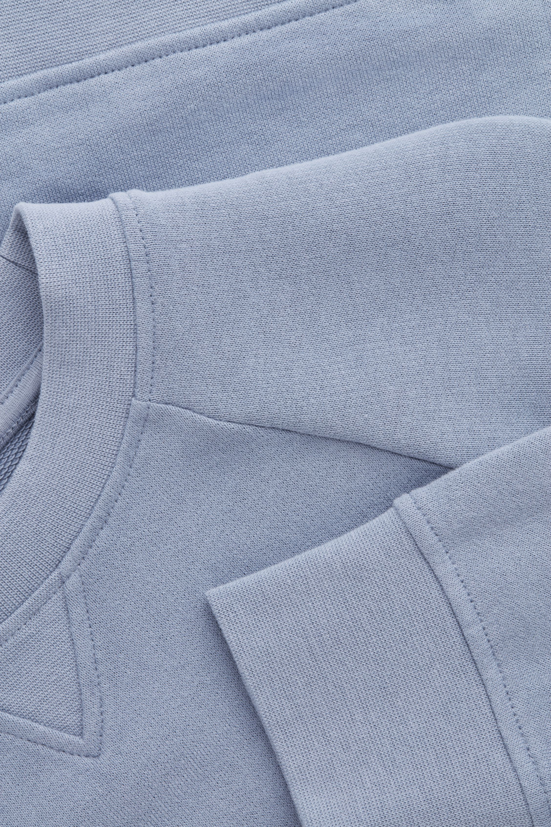 Side image of Cos relaxed jersey sweatshirt in blue