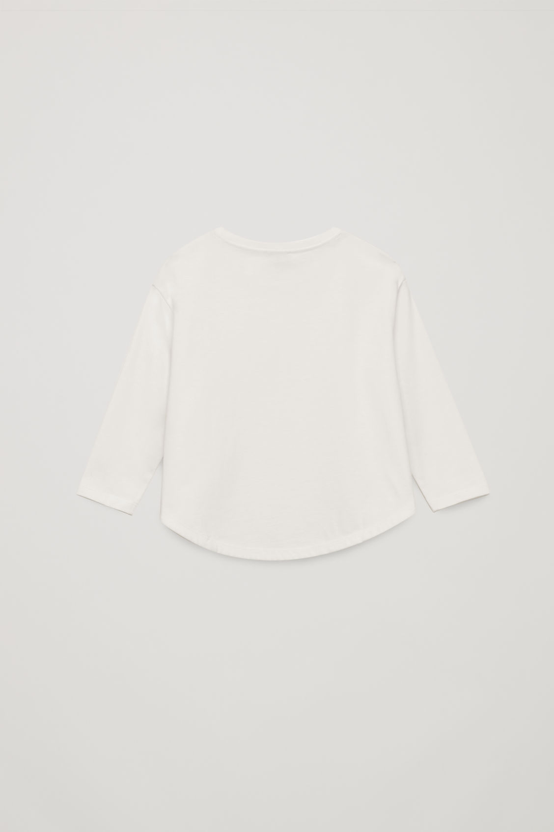 Side image of Cos circle-cut jersey top in white