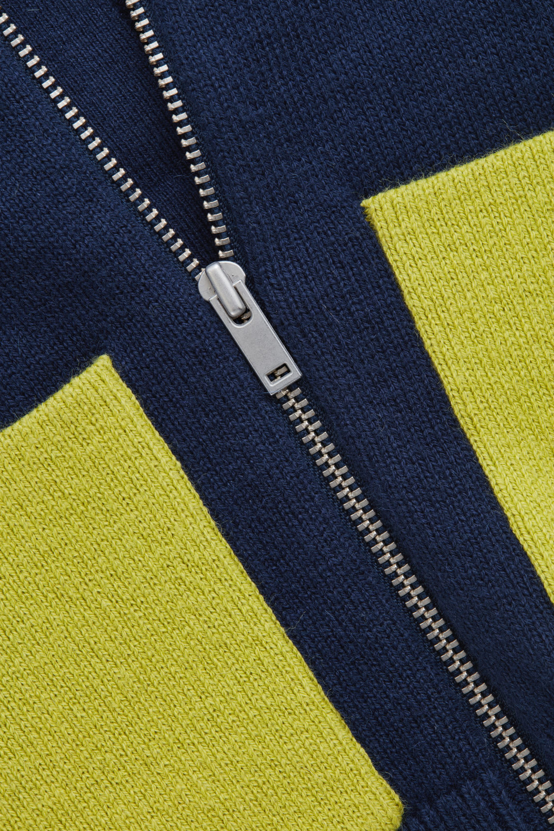 Side image of Cos patch pocket zip-up cardigan in blue