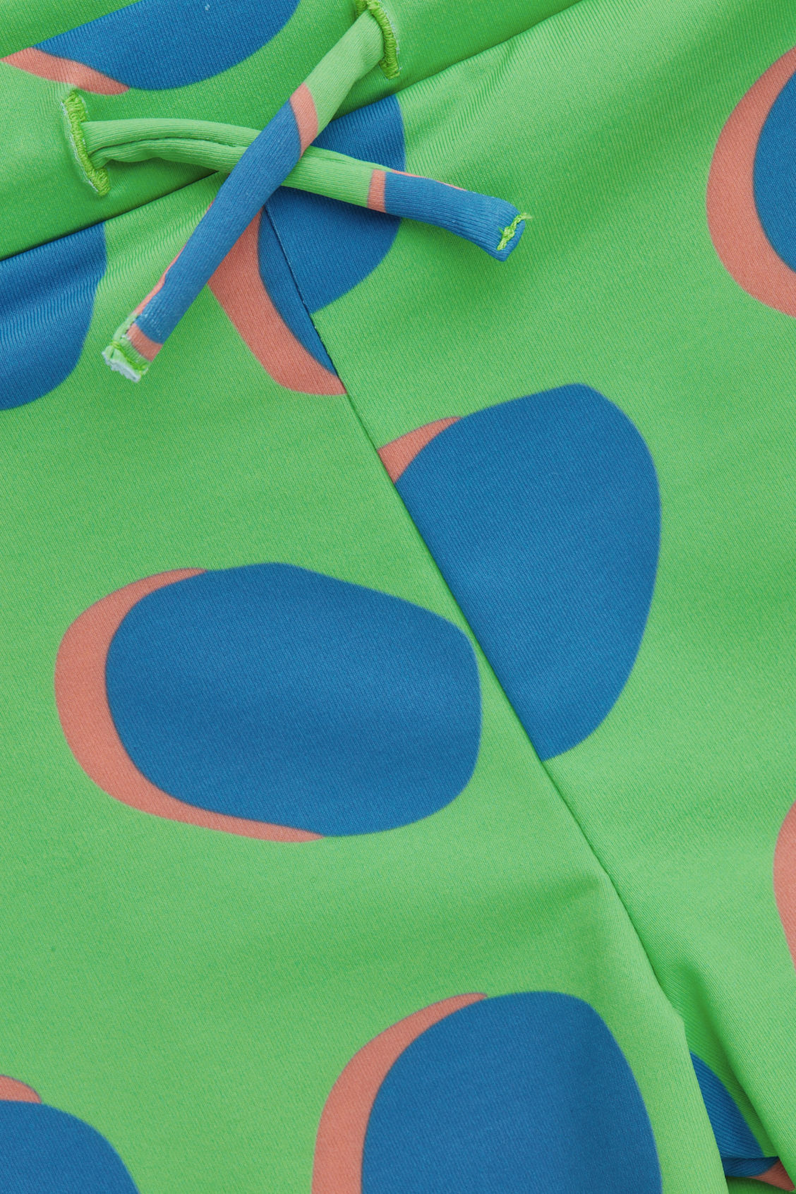 Side image of Cos printed swimming trunks in green