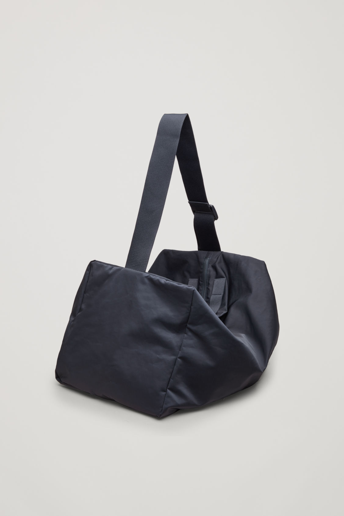 Side image of Cos collapsed technical holdall in blue