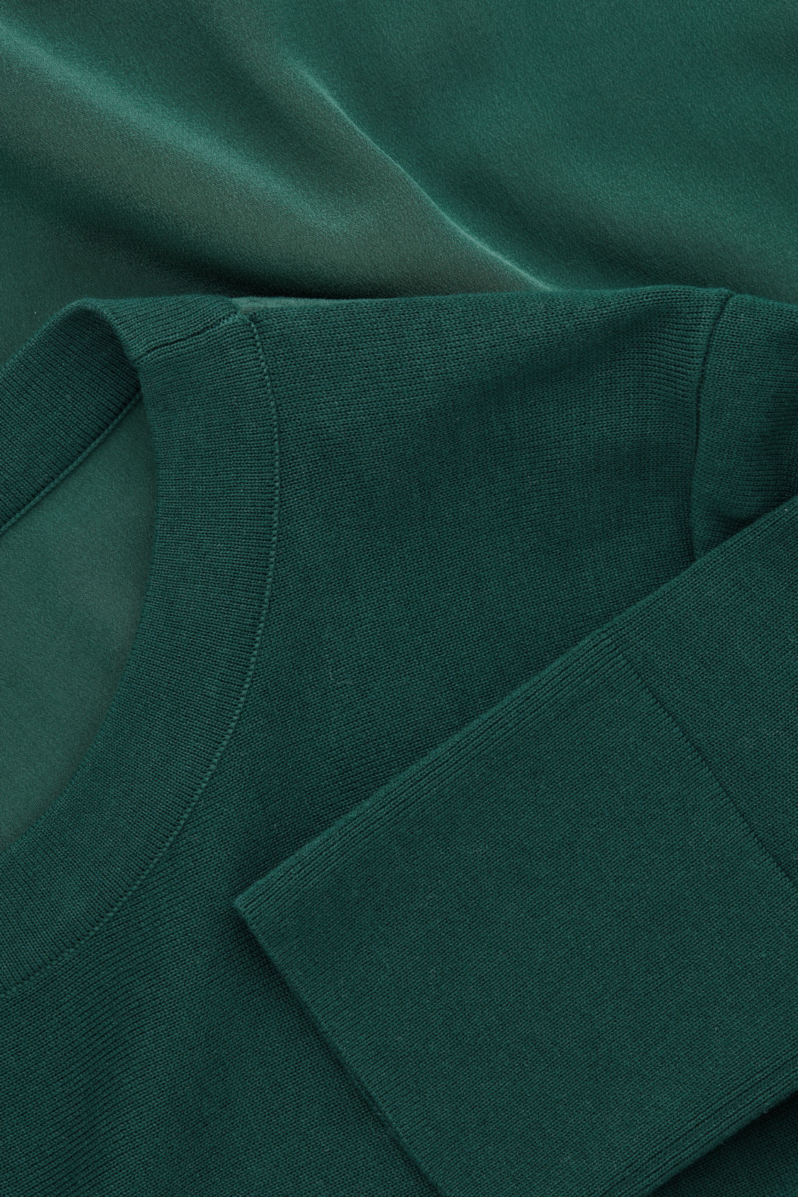 Side image of Cos knit top with silk panel in green
