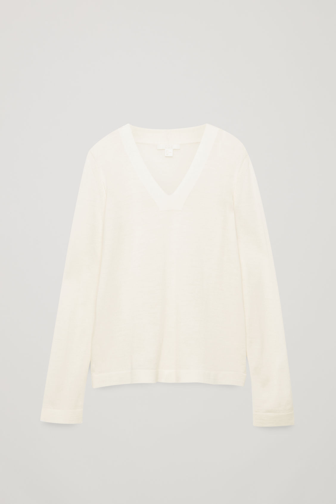 Front image of Cos merino jumper with deep v-neck in white