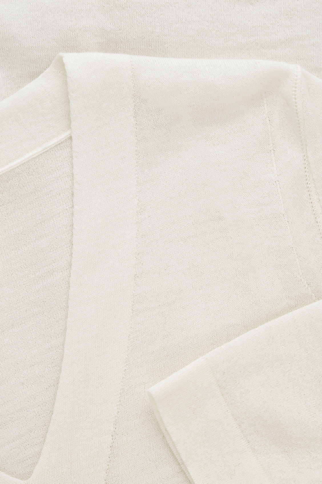 Side image of Cos merino jumper with deep v-neck in white