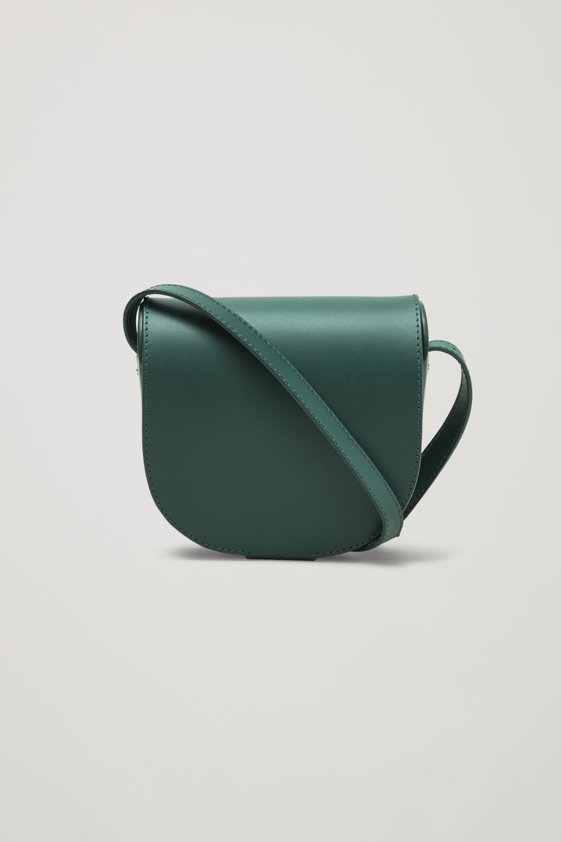 Front image of Cos small leather saddle bag in green