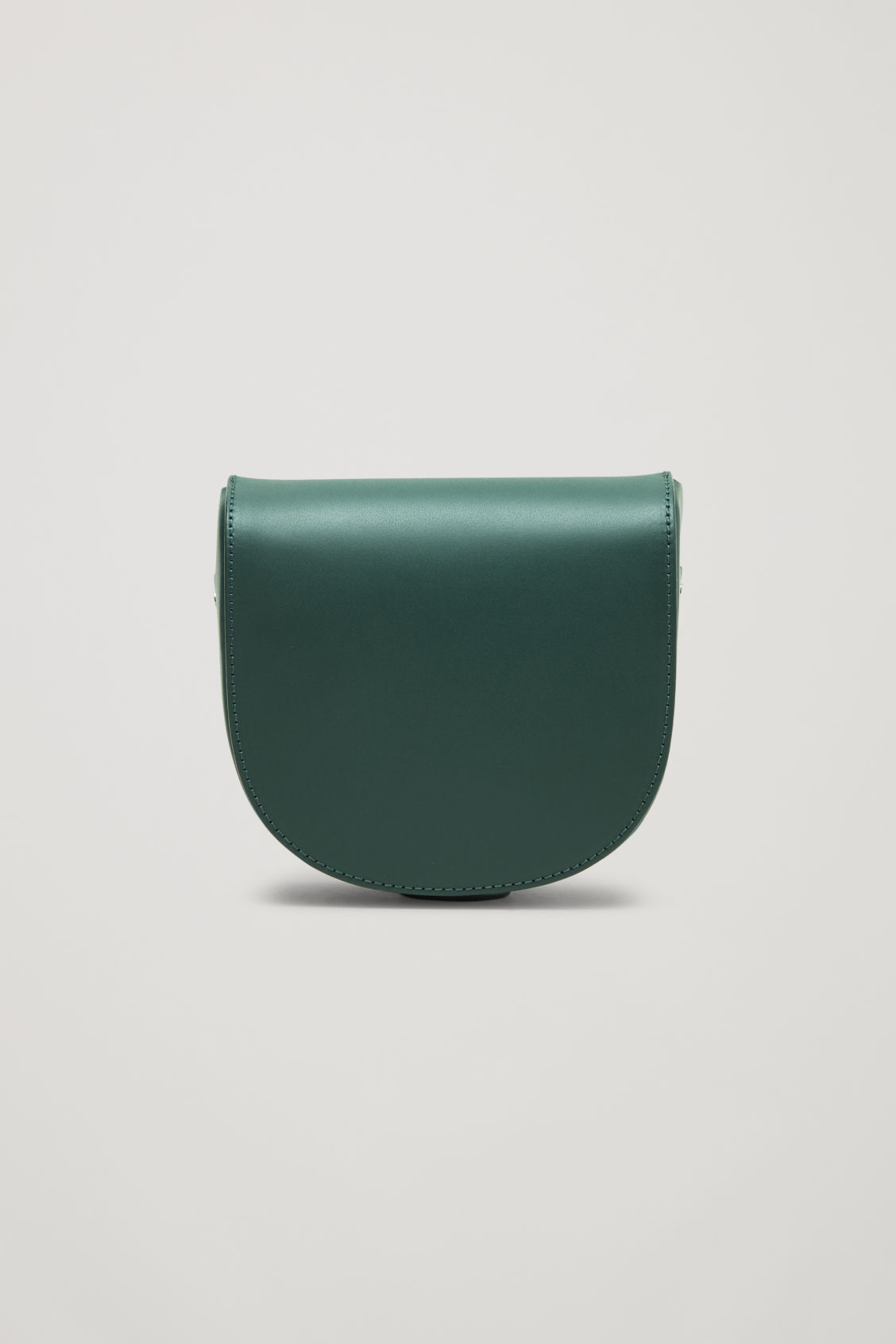Side image of Cos small leather saddle bag in green