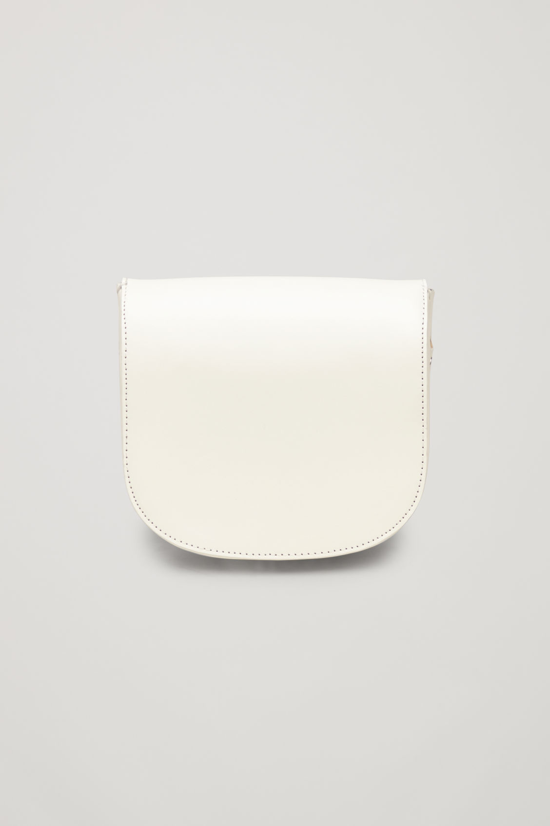 Side image of Cos small leather saddle bag in white