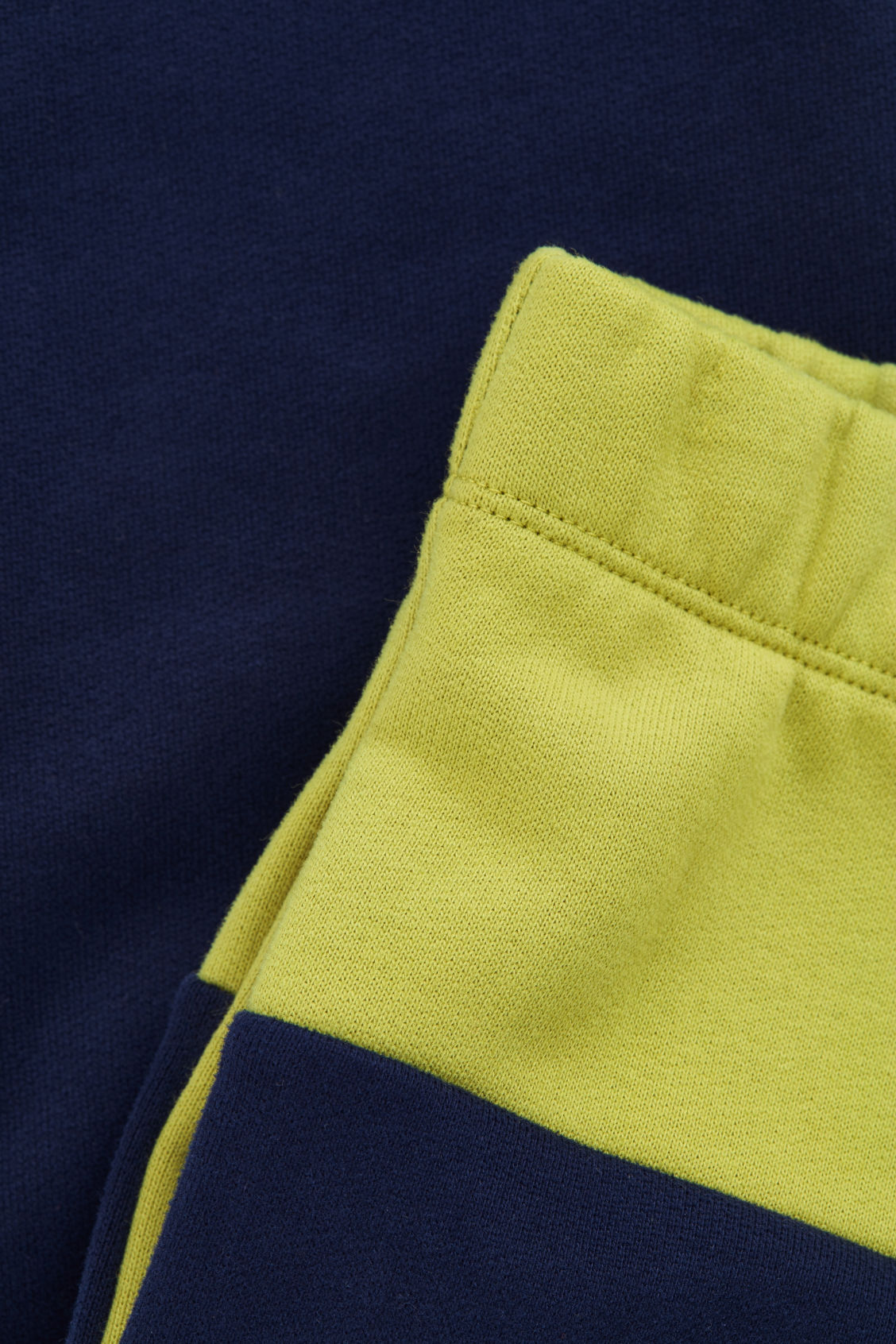 Side image of Cos colour-block jersey trousers in blue