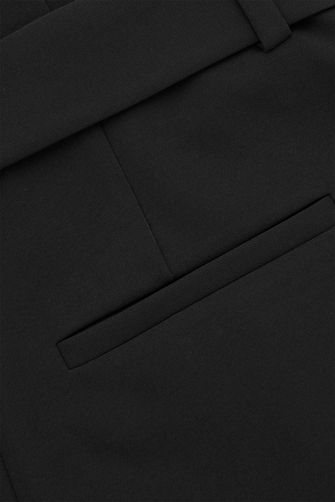 Side image of Cos d-ring belted paperbag trousers in black