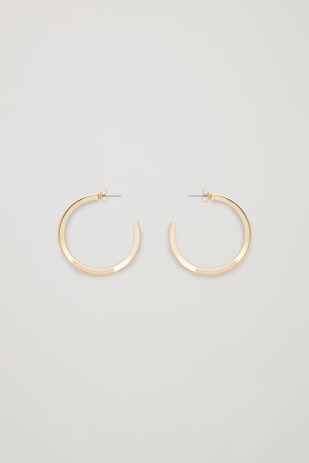 Front image of Cos open mid-hoop earrings  in gold