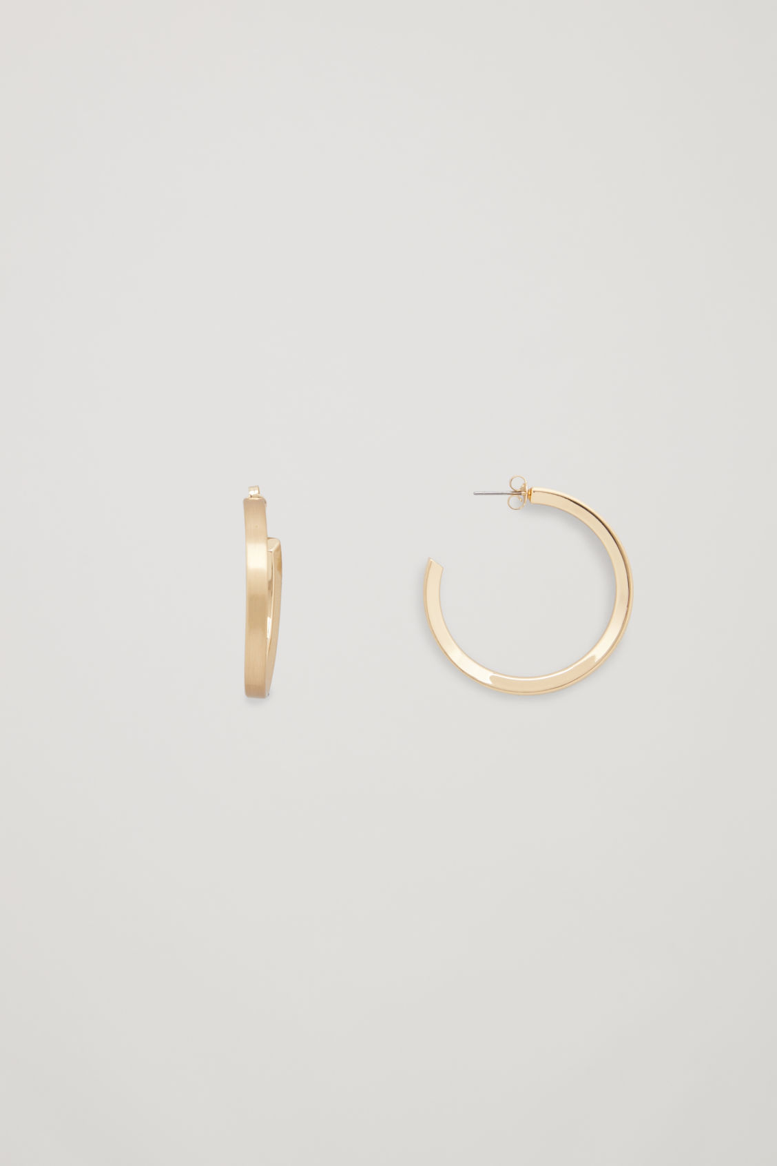 Side image of Cos open mid-hoop earrings  in gold