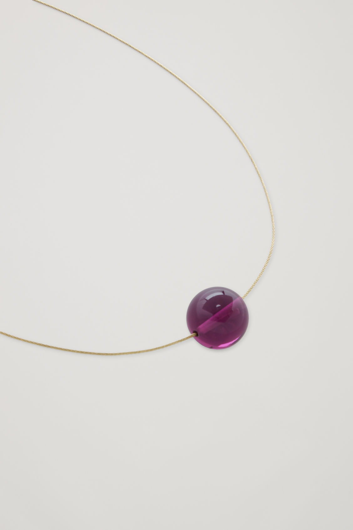 Side image of Cos short cord necklace  in red