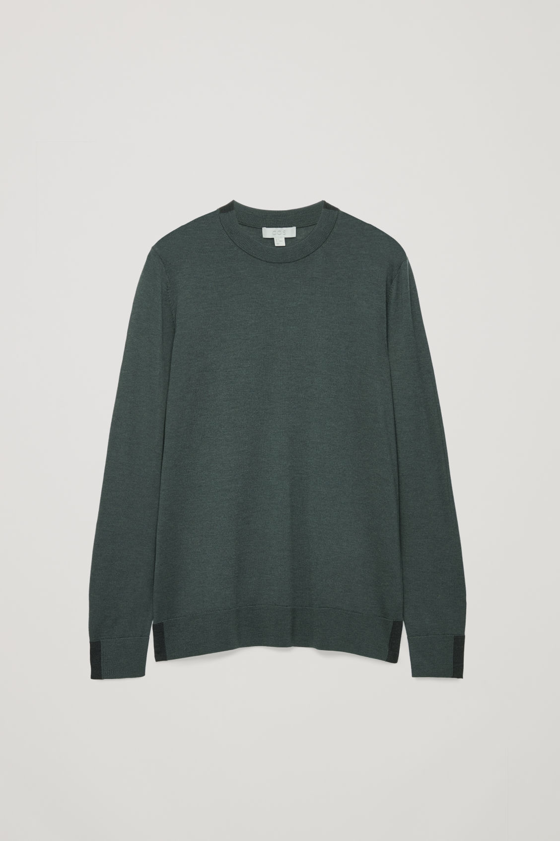 Front image of Cos merino jumper with trim detail in green