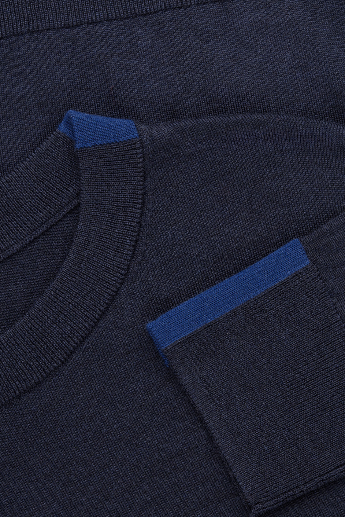 Side image of Cos merino jumper with trim detail in blue