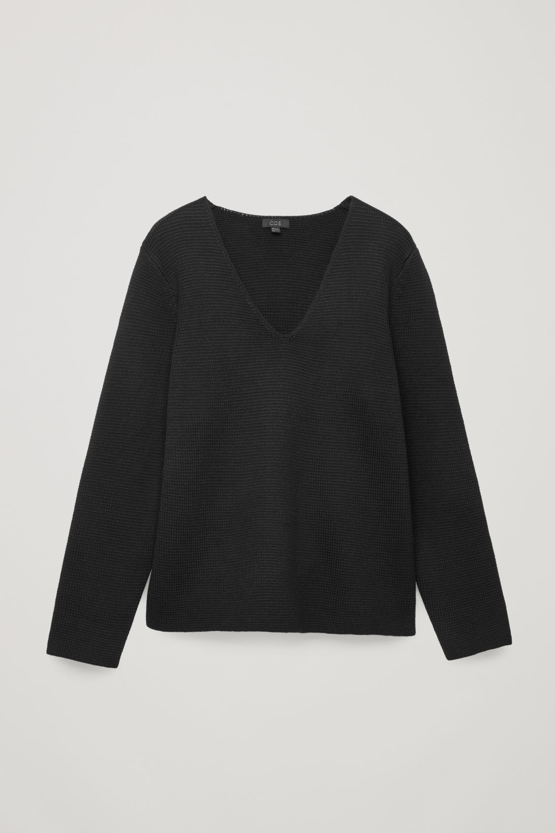 Front image of Cos wool v-neck jumper  in black