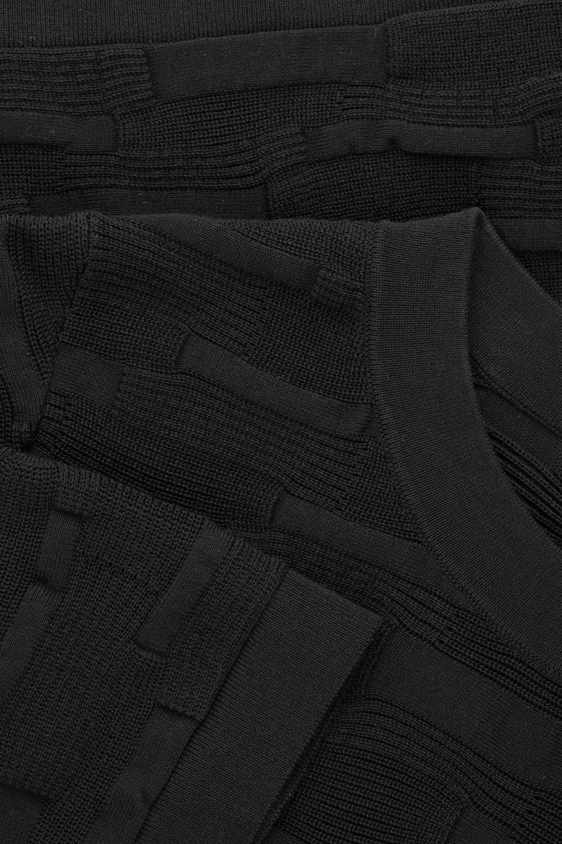 Side image of Cos irregular-stitch knit top in black