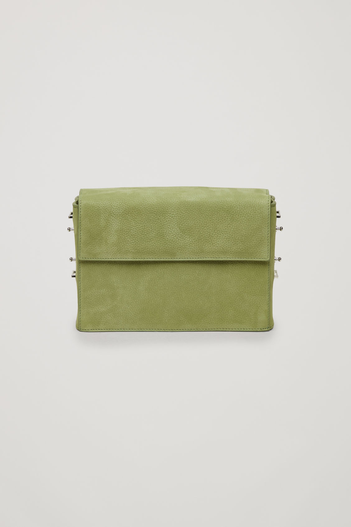 Side image of Cos double-flap box leather bag in green