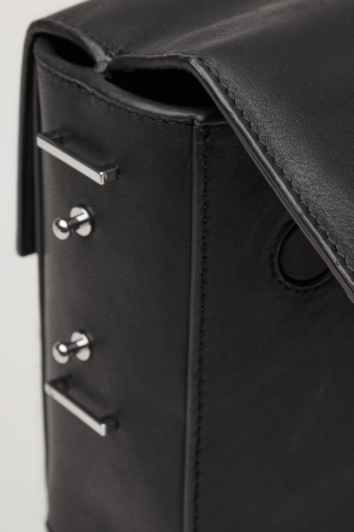 Side image of Cos double-flap box leather bag in black