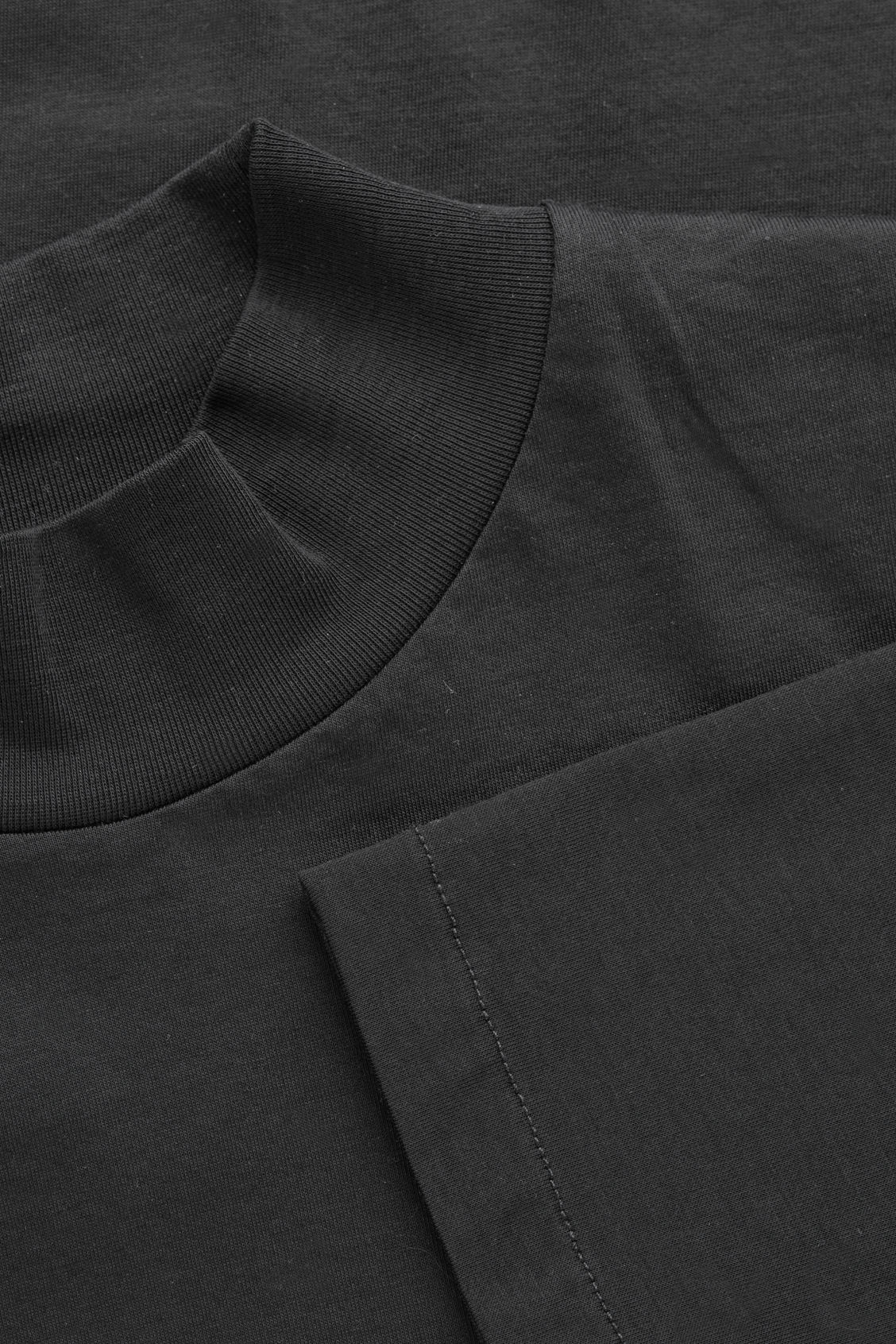 Side image of Cos cotton jersey roll-neck top in black