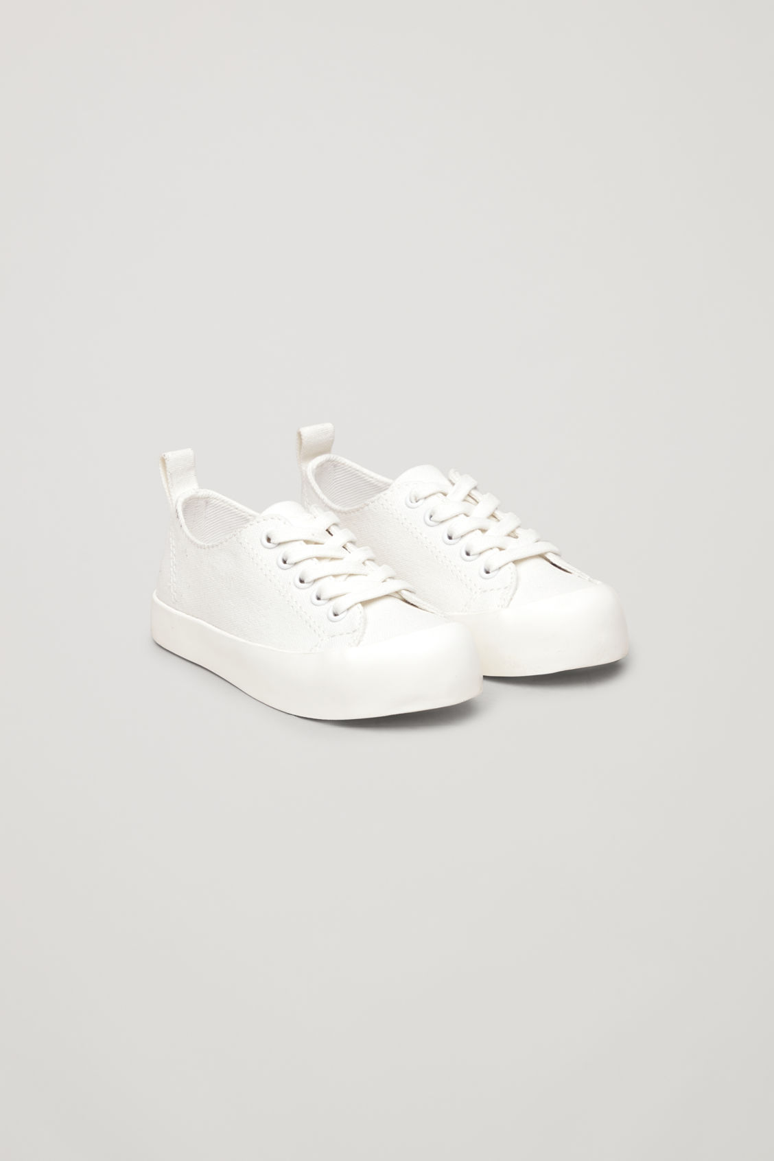 Front image of Cos lace-up canvas sneakers in white