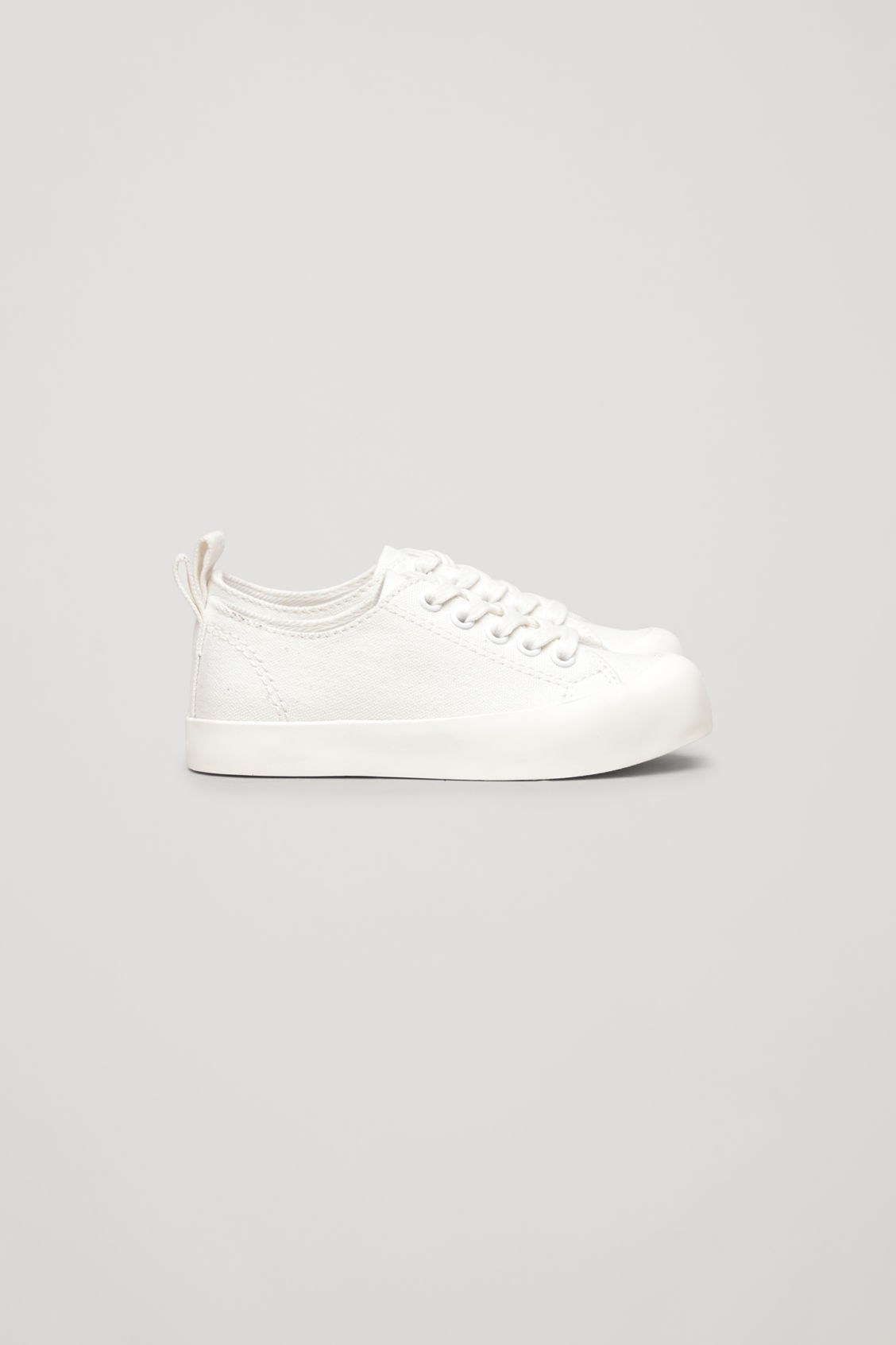 Side image of Cos lace-up canvas sneakers in white