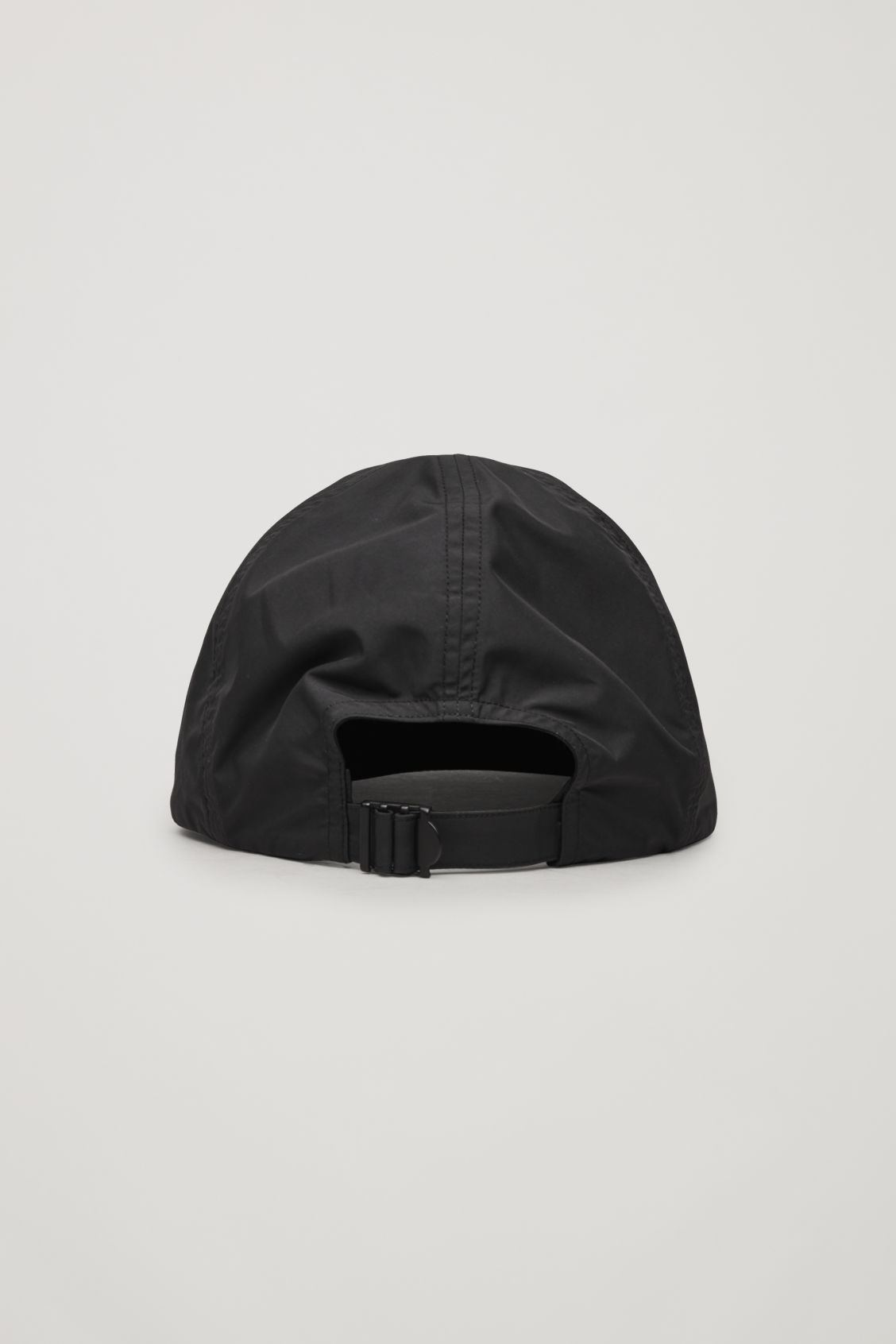 Side image of Cos technical soft cap in black