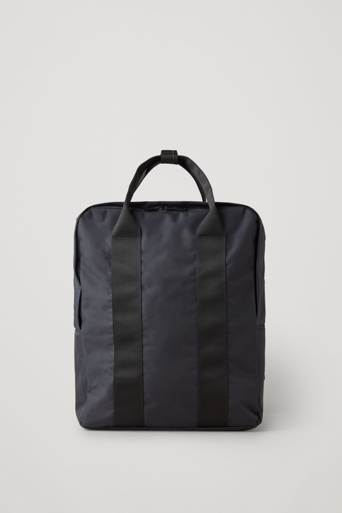 Front image of Cos technical tote backpack in blue
