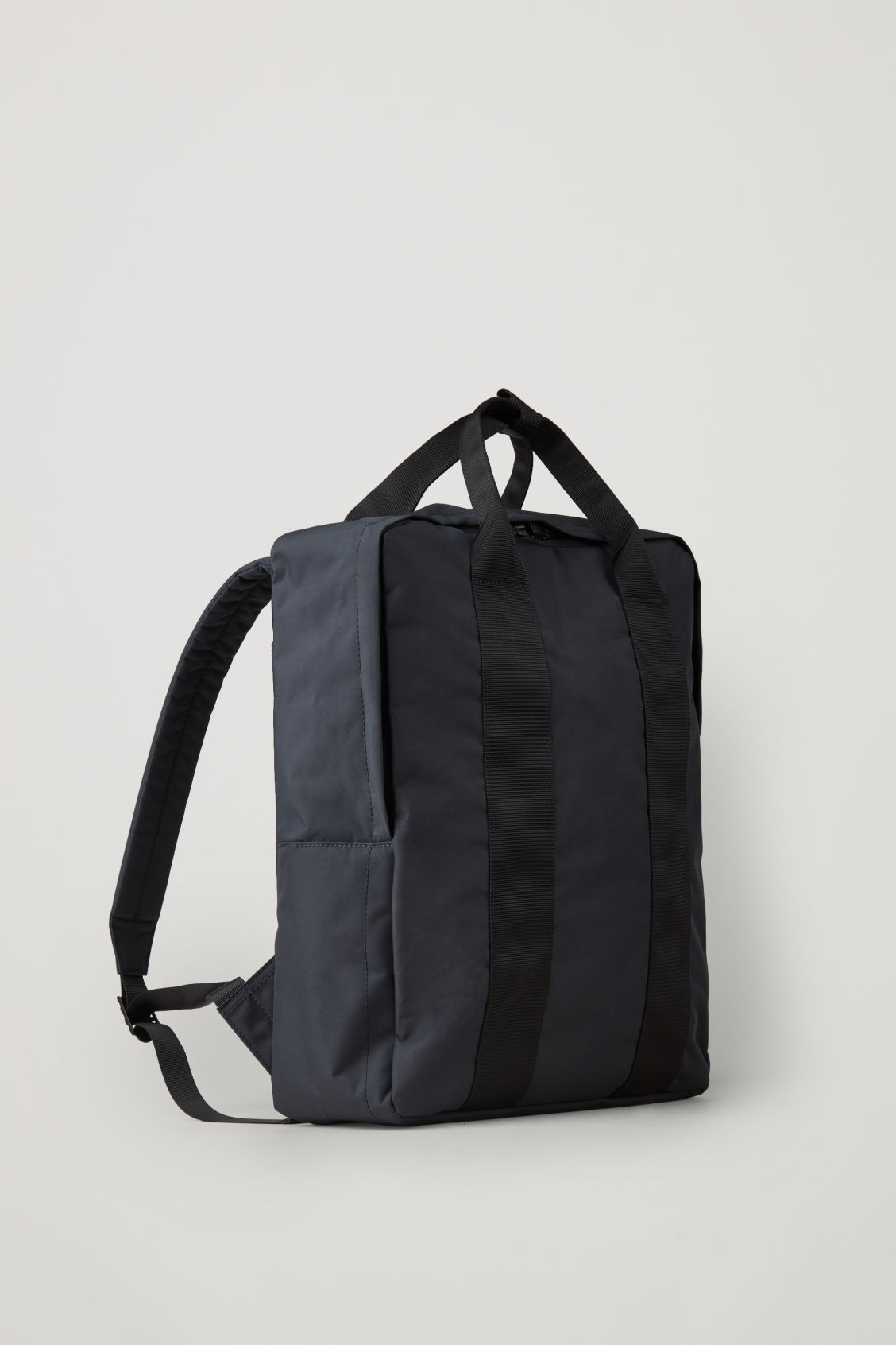 Side image of Cos technical tote backpack in blue
