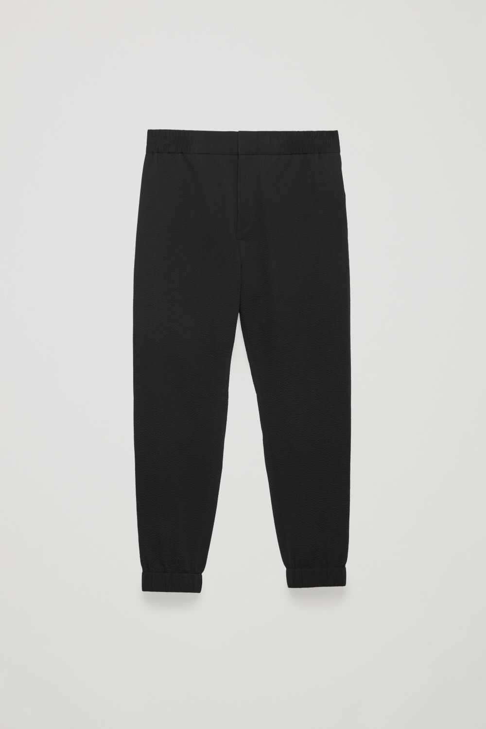 Front image of Cos relaxed seersucker trousers in black