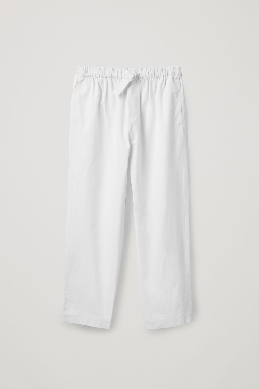 Front image of Cos relaxed cotton trousers with buckle  in white