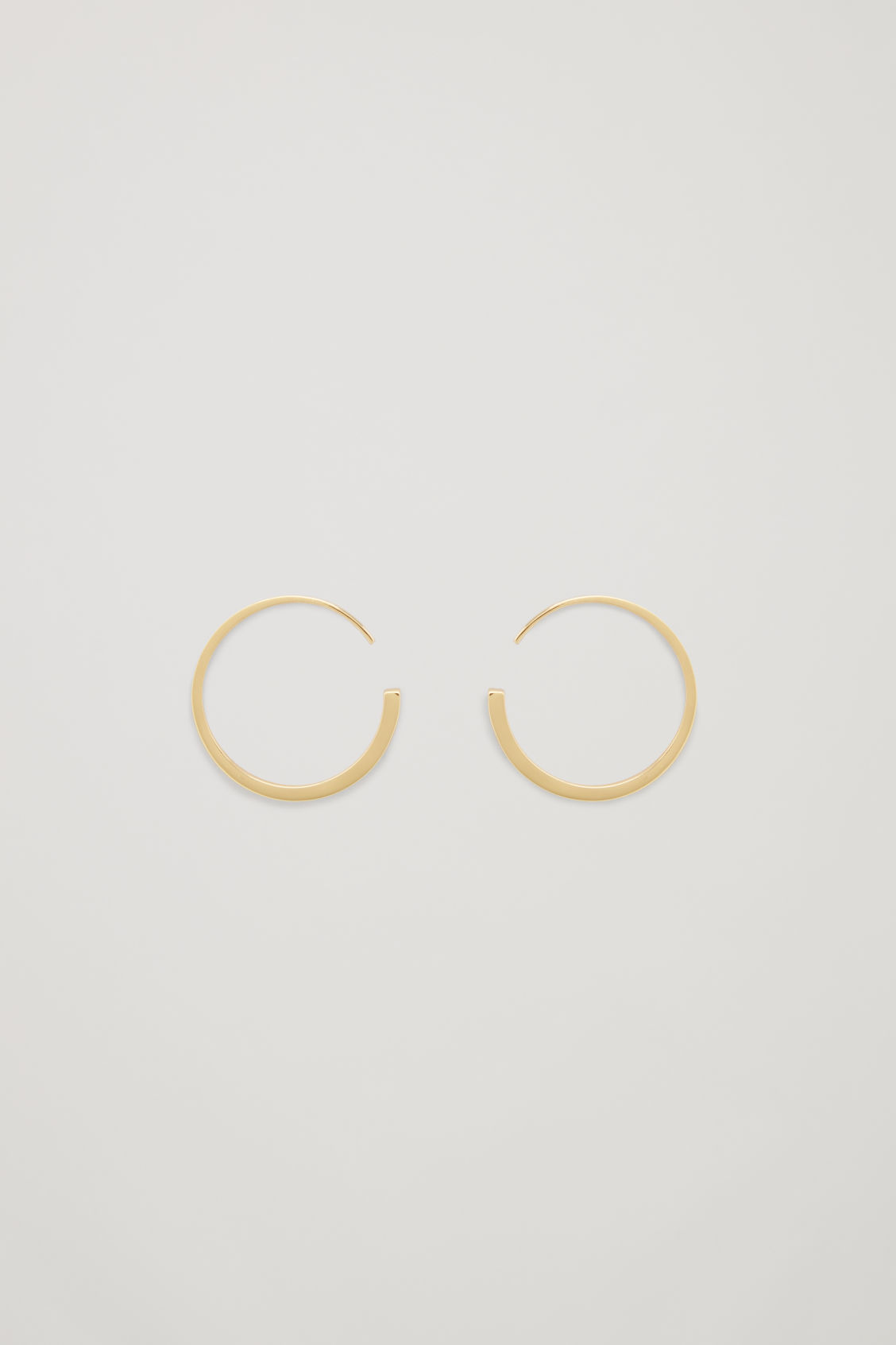 Front image of Cos narrow gradual hoop earrings  in gold