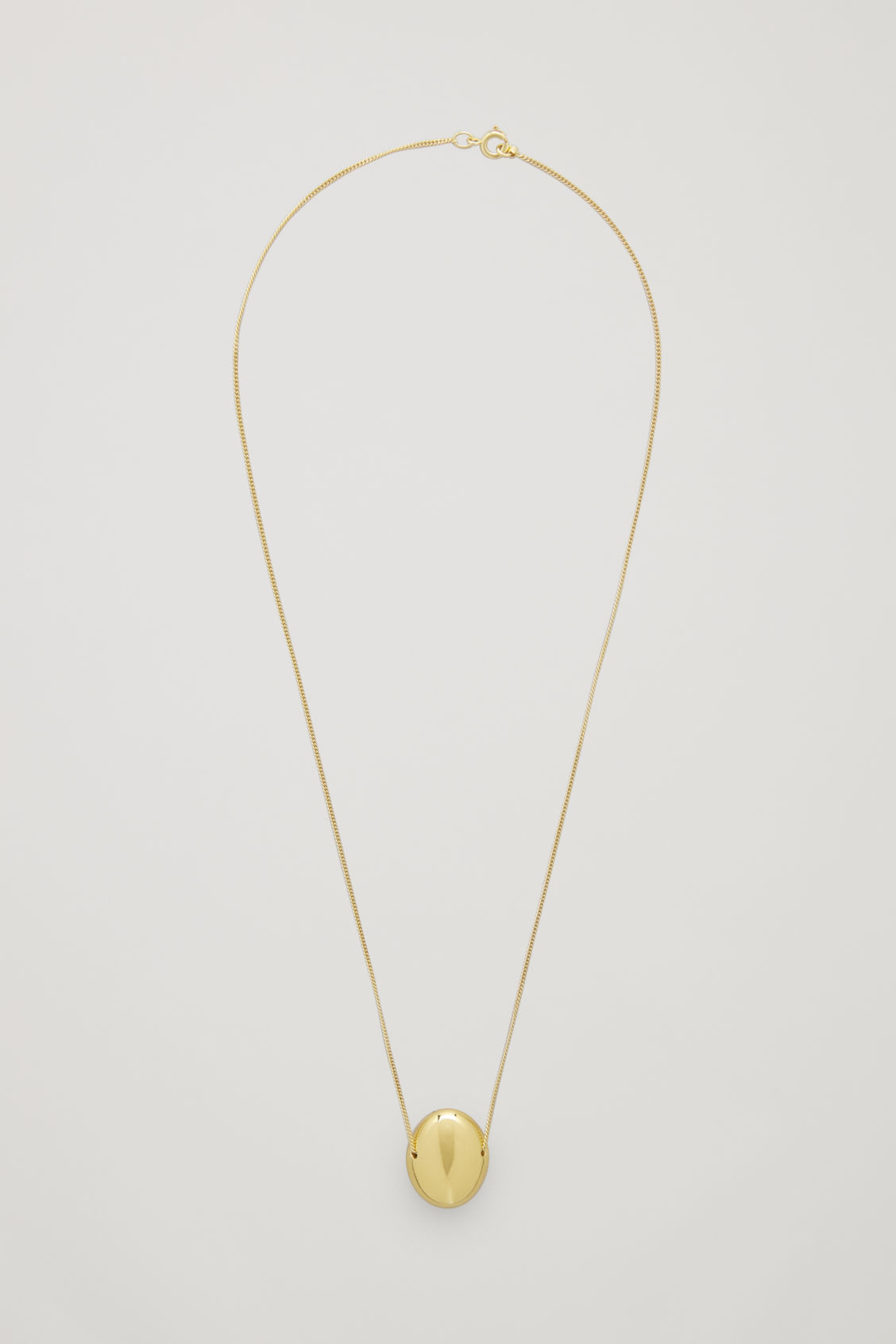 Front image of Cos curved gold-plated pendant necklace in gold
