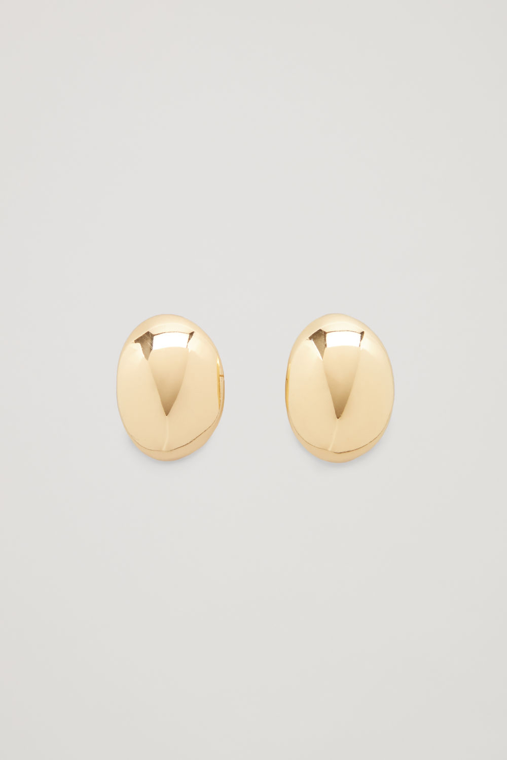 Front image of Cos curved gold-plated earrings in gold