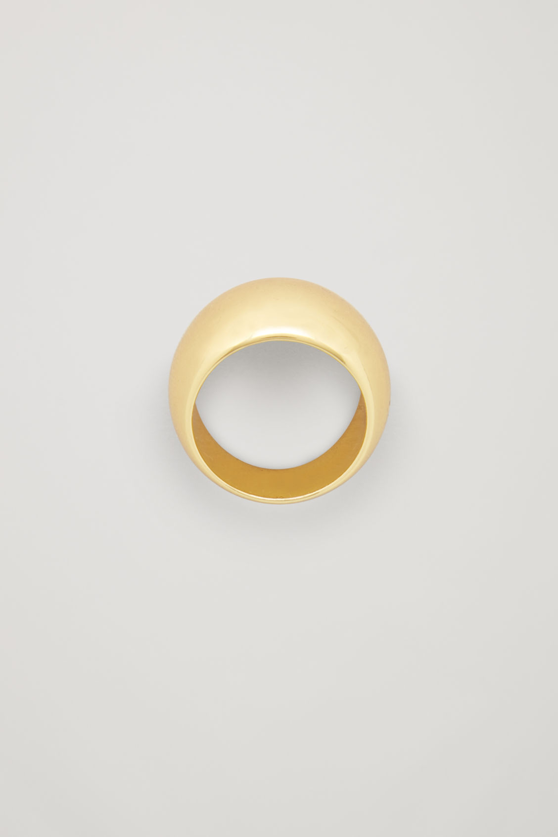 Front image of Cos wide curved gold-plated ring in gold