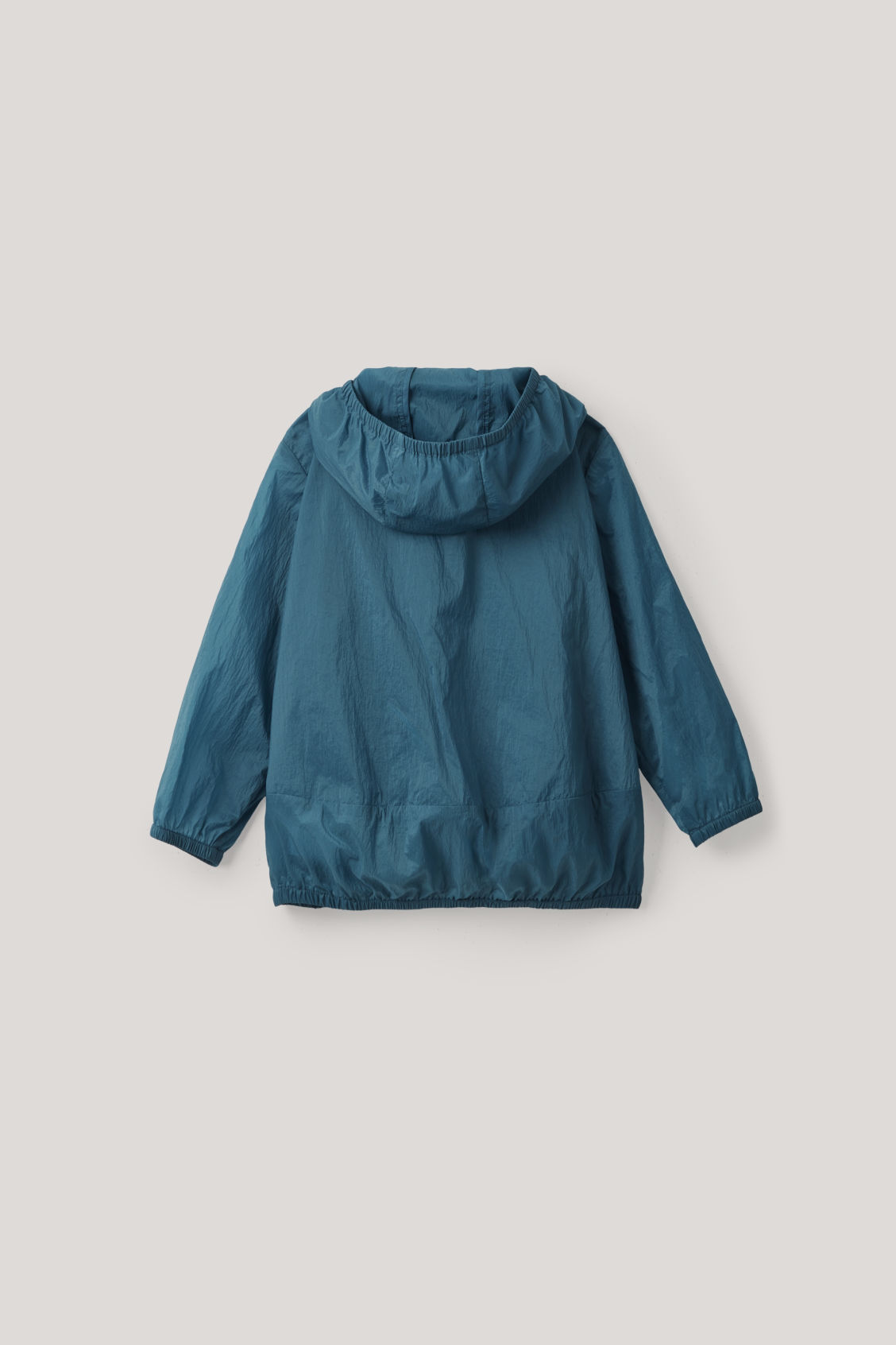 Side image of Cos packable lightweight jacket  in blue