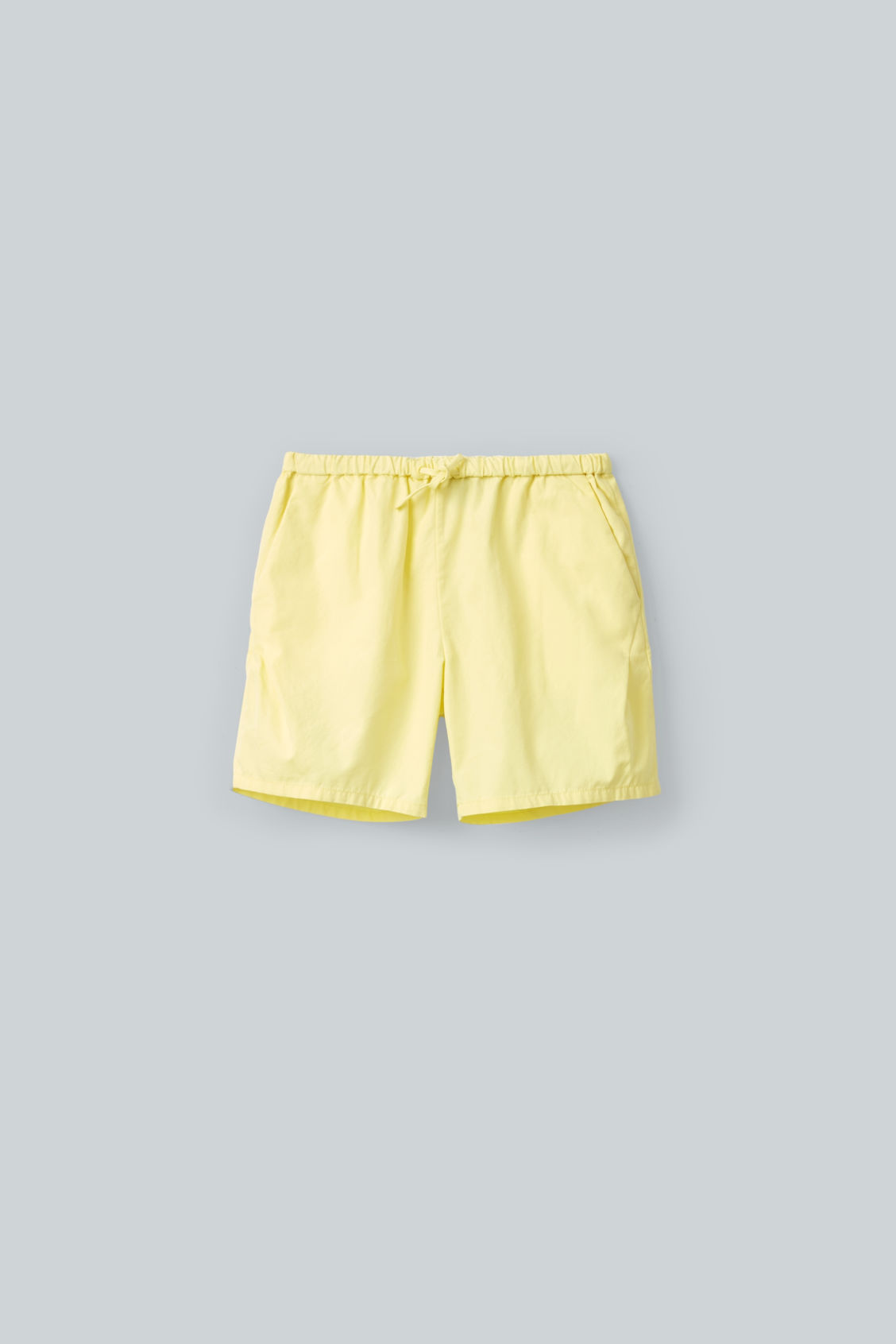 Front image of Cos drawstring cotton shorts in yellow