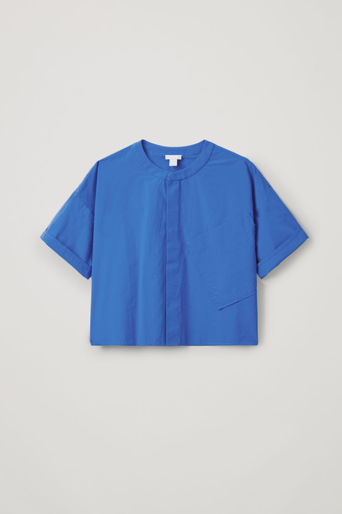 Front image of Cos relaxed shirt with slanted pocket  in blue