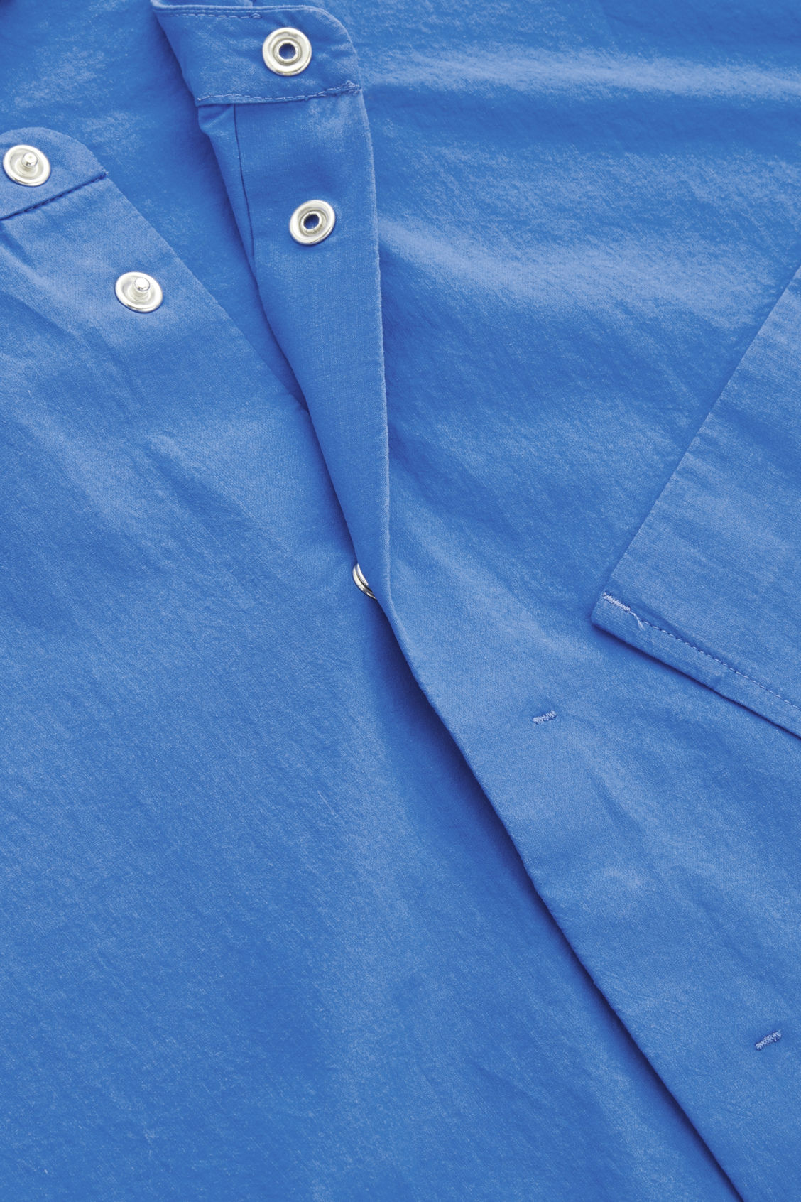 Side image of Cos relaxed shirt with slanted pocket  in blue