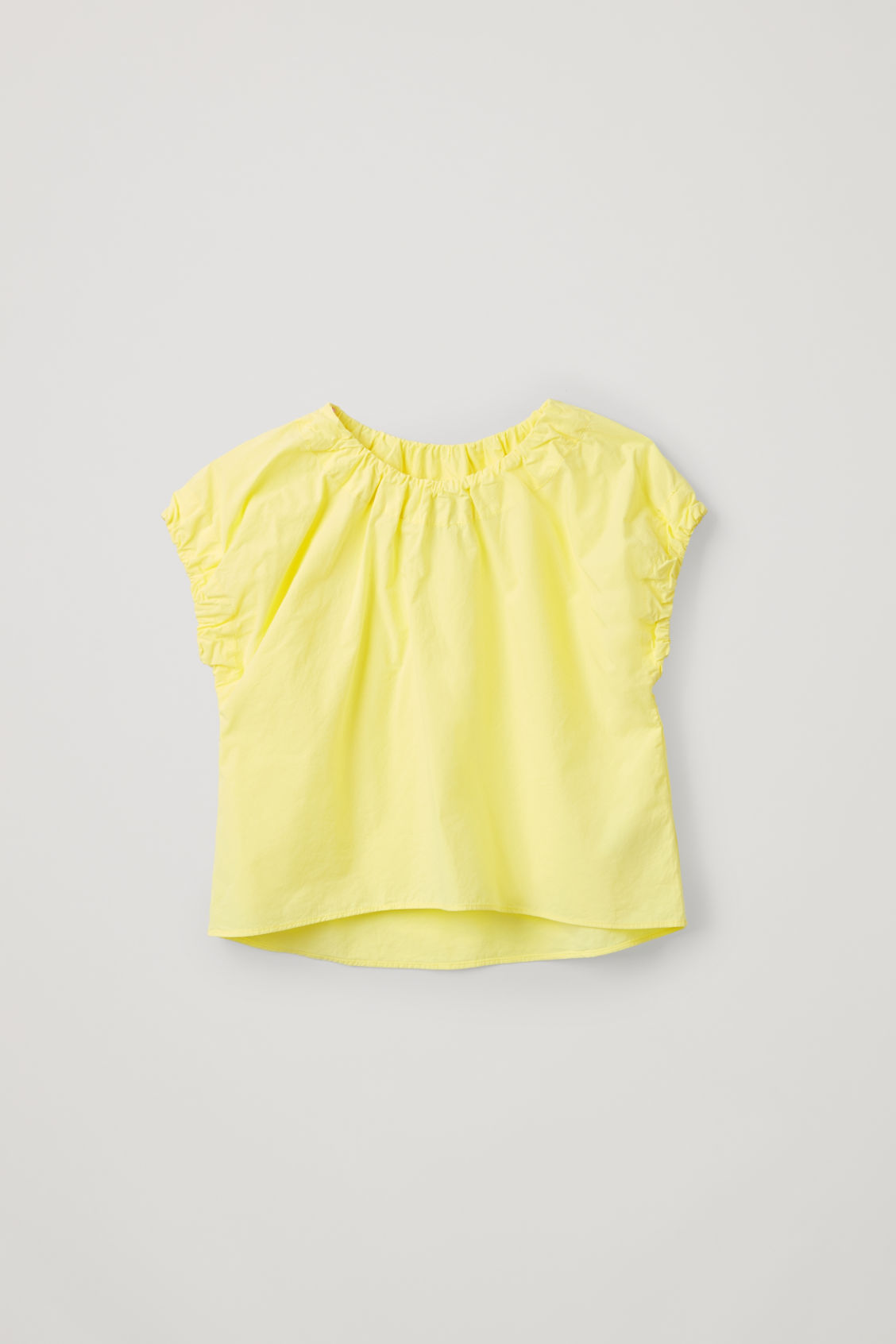 Front image of Cos cotton top with elastic detail in yellow