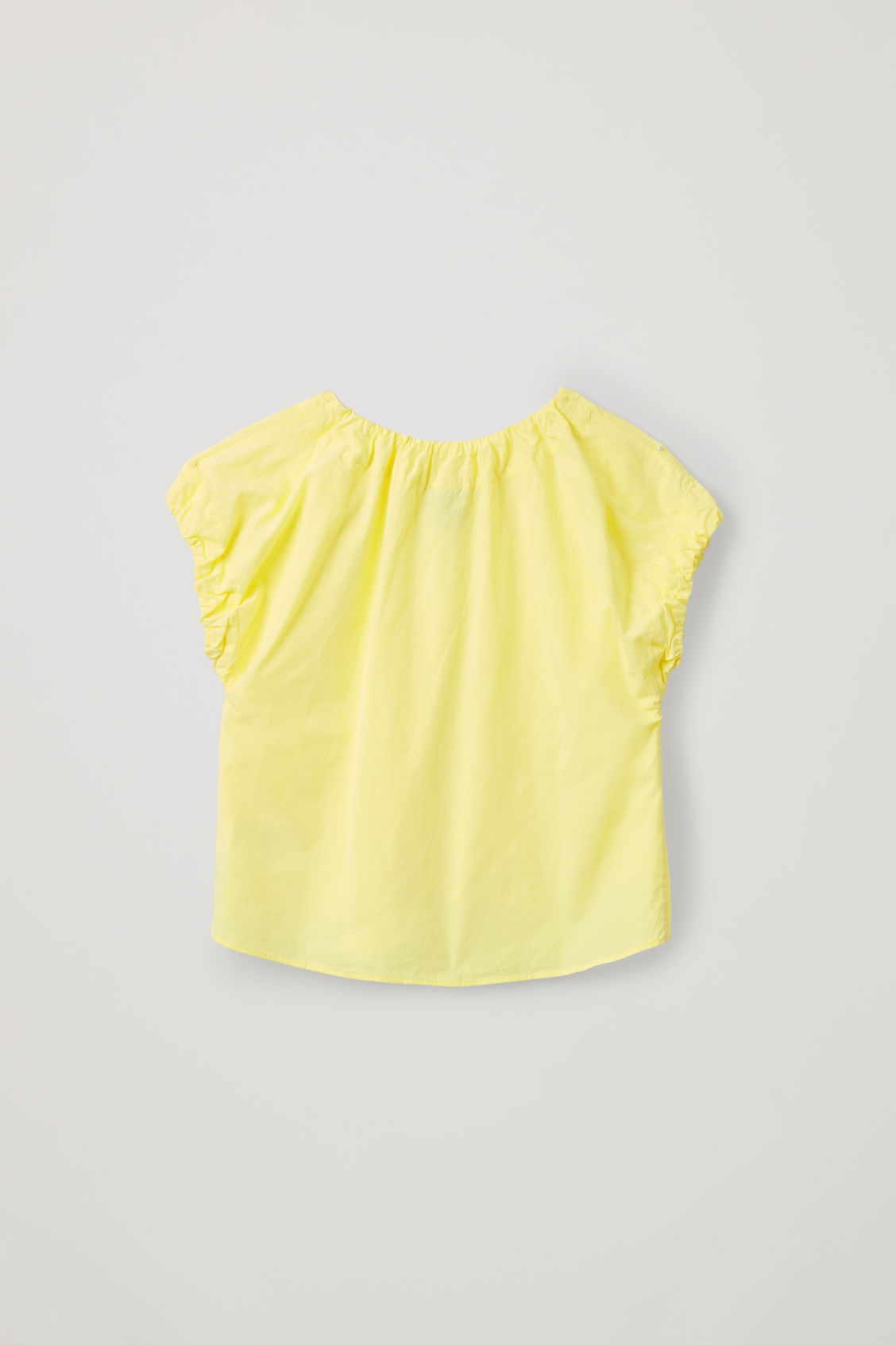 Side image of Cos cotton top with elastic detail in yellow