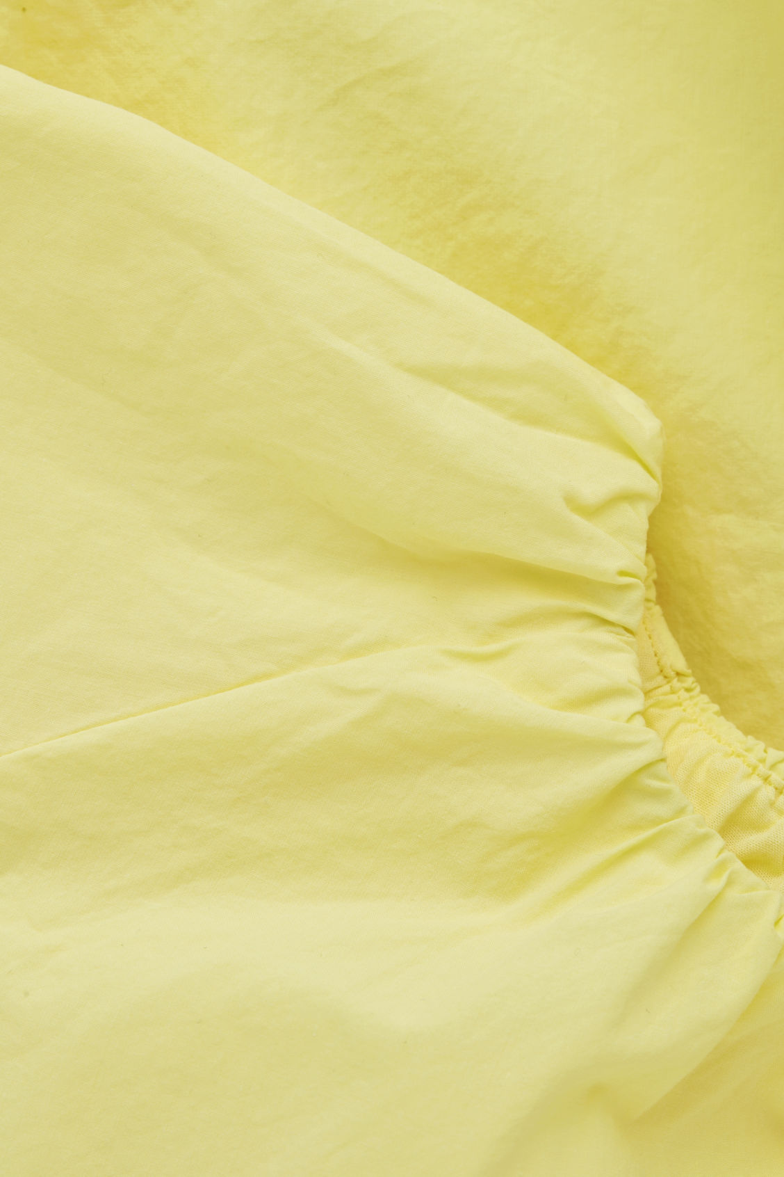 Side image of Cos voluminous-shape cotton dress in yellow